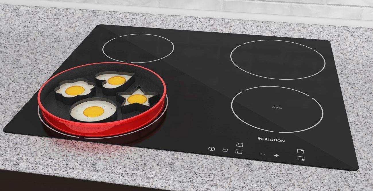 Gotowanie jajek w foremkach na czarnej płycie indukcyjnej